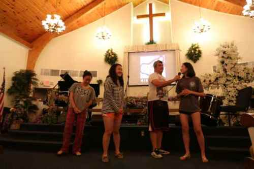 """At worship, sharing """"yeah God!"""" moments from the day"""