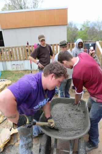 The boys try the old school wheelbarrow technique