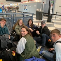 Sawyer, Daphne, Margaux, Jack, Justin, and Karinna waiting at check-in